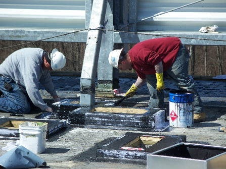 Reinforcing fabric installation on a roof top